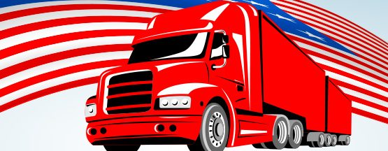 A red truck in front of the American Flag